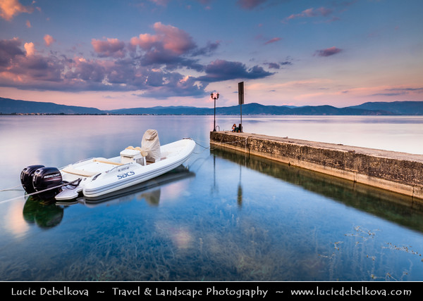 Europe - Macedonia - Ohrid Lake - Охридско Езеро - Ohridsko Ezero - UNESCO World Heritage Site - One of Europe's deepest & oldest lakes - Largest & most beautiful out of Macedonia's three tectonic lakes - Crystal clear water with lake pier at Sunset - Dusk