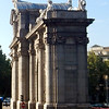 Puerta de Alcala, one of several such arches in Madrid.  This one is on a road that leads to the nearby city of Alcala de Henares