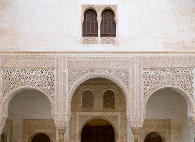 Intricate arabesque patterns adorn columns and entry ways of the Alhambra