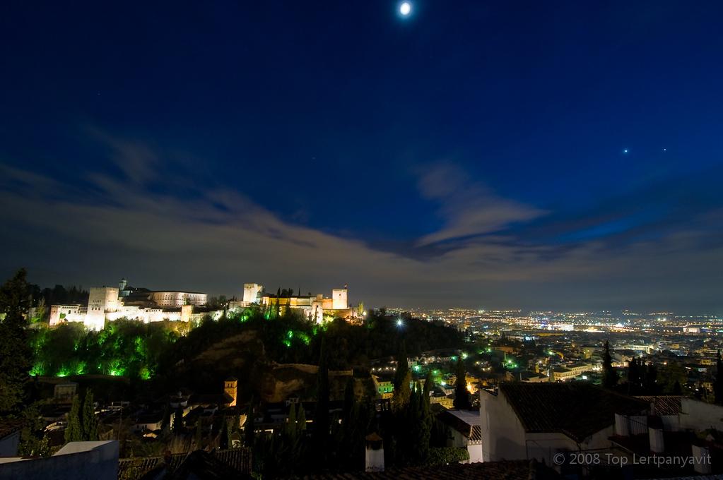Night photo of the Alhambra and the city of Granada from Mirador de San Nicholas  in the Albayzín