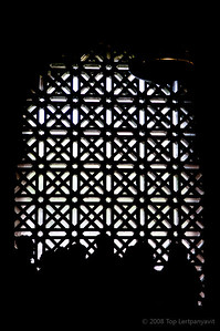 People silhouetted against a screen in the Mezquita in Cordoba