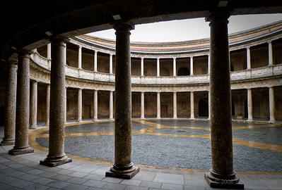 Circular and stark  courtyard of the Palace of Charles V in the Alhambra