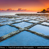 Southern Europe - Malta - Island of Gozo - Għawdex - Isle of Calypso - Small island of the Maltese archipelago in the Mediterranean Sea - Marsaskala - Marsascala - Xwejni Bay - Low shelving rock ledges cut with salt pans on the seaward face at warm morning sunrise