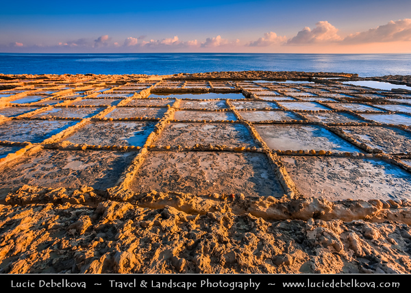 Southern Europe - Malta - Island of Gozo - Għawdex - Isle of Calypso - Small island of the Maltese archipelago in the Mediterranean Sea - Marsaskala - Marsascala - Xwejni Bay - Low shelving rock ledges cut with salt pans on the seaward face at warm morning sunrise