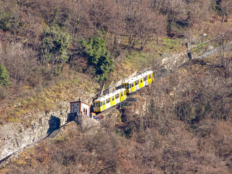 The two cars of the funicular railway passing each other at the halfway point. The railway connects Como to Brunate, a village on top of the mountain.