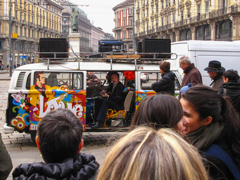 Bnad playing in a van on the street in Milan