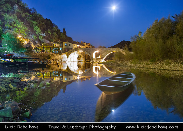 Europe - Montenegro - Crna Gora -  Црна Гора - Skadarsko Jezero - Skadar Lake National Park - Historic stone bridge in Rijeka Crnojevica at Skutari lake - Dusk - Blue Hour - Twillight - Night
