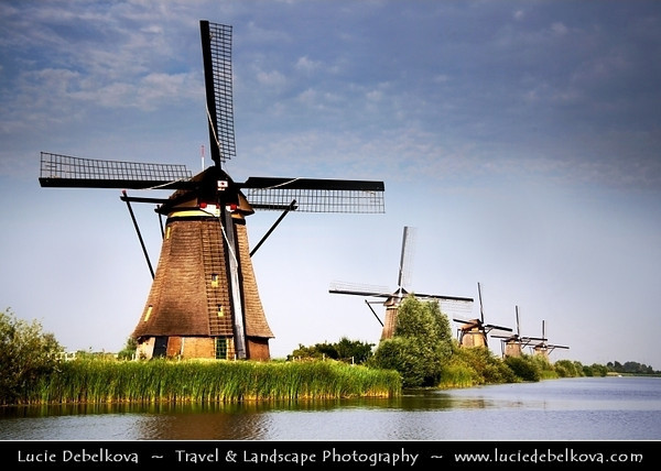 Netherlands - Kinderdijk - System of 19 windmills built around 1740 situated in a polder at the confluence of the Lek and Noord rivers - Largest concentration of old windmills in the Netherlands - UNESCO World Heritage Site <br /> <br /> Camera Model: Canon EOS 5D Mark II; Lens: 28.00 - 300.00 mm; Focal length: 70.00 mm; Aperture: 9.0; Exposure time: 1/250 s; ISO: 200