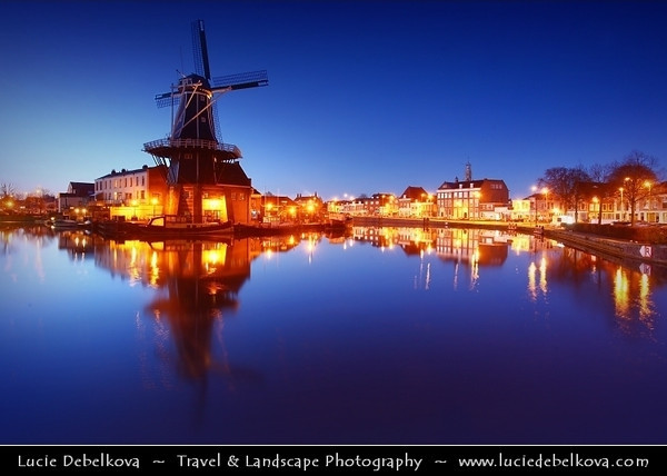 Netherlands - Haarlem - Historical center of the tulip bulb-growing district for centuries - Bloemenstad - Flower city - Blue Hour - Twilight - Dawn at the Windmill De Adriaan on river Spaarne <br /> <br /> Camera Model: Canon EOS 5D Mark II; Lens: 17.00 - 40.00 mm; Focal length: 21.00 mm; Aperture: 9.0; Exposure time: 32.0 s; ISO: 250