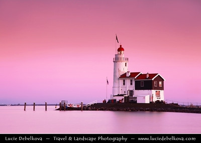 Netherlands - IJsselmeer - Sunset over Marken Lighthouse on peninsula in IJsselmeer - Commonly known as the 'Horse of Marken' with characteristic shape with the tall, built-on keeper's house   Camera Model: Canon EOS 5D Mark II; Lens: 24.00 - 105.00 mm; Focal length: 105.00 mm; Aperture: 22; Exposure time: 8.0 s; ISO: 100