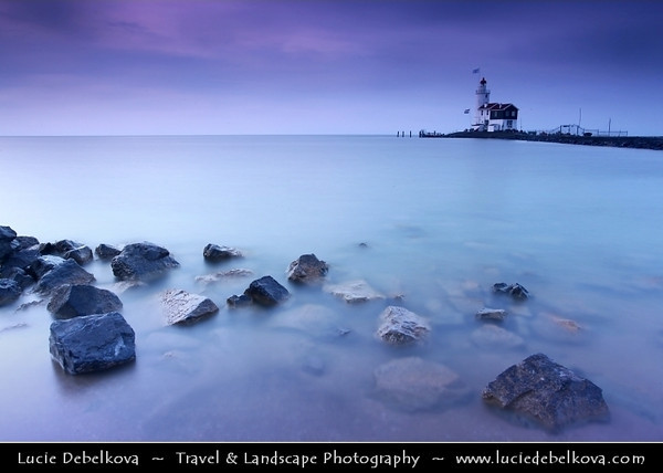 Netherlands - IJsselmeer - Dawn at Marken Lighthouse on peninsula in IJsselmeer - Commonly known as the 'Horse of Marken' with characteristic shape with the tall, built-on keeper's house <br /> <br /> Camera Model: Canon EOS 5D Mark II; Lens: 17.00 - 40.00 mm; Focal length: 23.00 mm; Aperture: 18; Exposure time: 32.0 s; ISO: 100