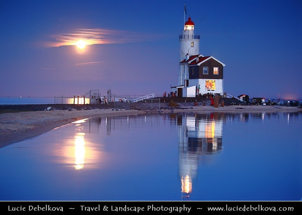 Netherlands - IJsselmeer - Giant Moon Rise over Marken Lighthouse on peninsula in IJsselmeer - Commonly known as the 'Horse of Marken' with characteristic shape with the tall, built-on keeper's house <br /> <br /> Camera Model: Canon EOS 5D Mark II; Lens: 70.00 - 200.00 mm; Focal length: 97.00 mm; Aperture: 4.0; Exposure time: 0.4 s; ISO: 3200