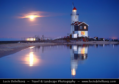 Netherlands - IJsselmeer - Giant Moon Rise over Marken Lighthouse on peninsula in IJsselmeer - Commonly known as the 'Horse of Marken' with characteristic shape with the tall, built-on keeper's house   Camera Model: Canon EOS 5D Mark II; Lens: 70.00 - 200.00 mm; Focal length: 97.00 mm; Aperture: 4.0; Exposure time: 0.4 s; ISO: 3200