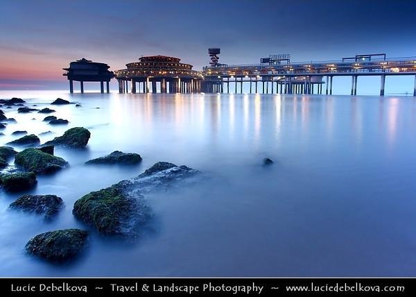 Netherlands - Scheveningen - Modern seaside resort on Shores of the North Sea with a long sandy beach, esplanade, pier & lighthouse - Twilight - Dusk - Blue Hour <br /> <br /> Camera Model: Canon EOS 5D Mark II; Lens: 17.00 - 40.00 mm; Focal length: 19.00 mm; Aperture: 10; Exposure time: 32.0 s; ISO: 100