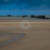 """""""Arromanches""""<br /> <br /> The Mulberry harbour was a portable temporary harbour developed by the British in World War II to facilitate rapid offloading of cargo onto the beaches during the Allied invasion of Normandy.<br /> <br /> ~ Image by Martin McKenzie All Rights Reserved ~"""