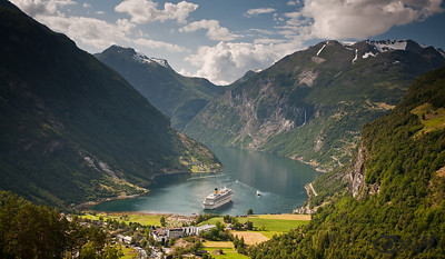 Geirangerfjord, UNESCO World Heritage Site.  If there is a picture-perfect fjord, it is Geirangerfjord- sheer walls with waterfalls seemingly everywhere, snowcapped mountains around it, farms clinging to the rocks midway between water, and snow and deep blue fjord in the center of it all.