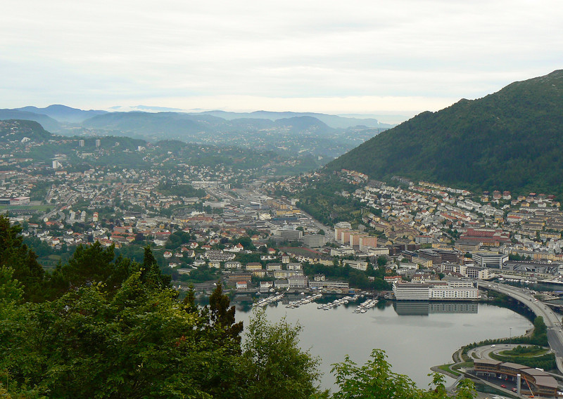 Looking down onto the buildings of Bergen from the top of a mountain