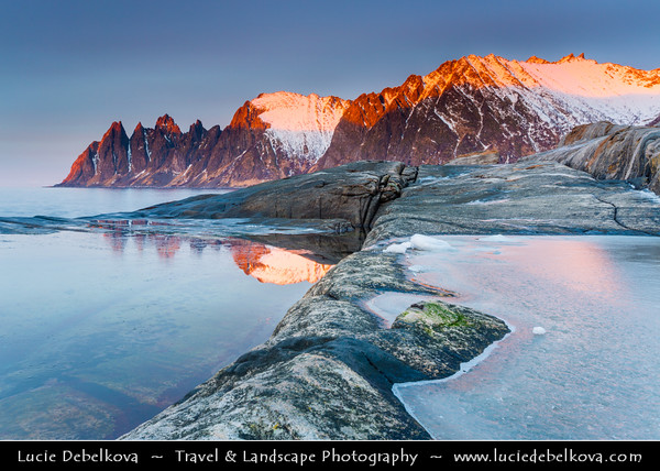 Europe - Scandinavia - Norway - North of the Arctic Circle - Troms county - Senja - Norway's second biggest island - Devil's Jaw - Oskornan mountains taken from the beach of Tungeneset under fresh cover of snow during winter time at Sunset - Dusk - Twilight - Blue Hour - Night