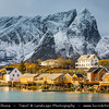 Europe - Scandinavia - Norway - North of the Arctic Circle - Nordland county - Lofoten islands archipelago - Moskenes - Hamnoy - Hamnøy - Picturesque fishing village under fresh cover of snow during winter time - World Famous Norwegian Dried Cod Fish