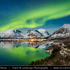 Europe - Scandinavia - Norway - North of the Arctic Circle - Troms county - Senja - Norway's second biggest island - Bergsfjorden and its surrounding mountains under fresh cover of snow during winter time with Aurora borealis - Northern light - Produced by solar wind particles guided by Earth's field lines to the top of the atmosphere