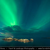 Europe - Scandinavia - Norway - North of the Arctic Circle - Nordland county - Lofoten islands archipelago - Moskenes - Hamnoy - Hamnøy - Picturesque fishing village under fresh cover of snow during winter time - Aurora borealis - Northern light - Produced by solar wind particles guided by Earth's field lines to the top of the atmosphere