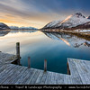Europe - Scandinavia - Norway - North of the Arctic Circle - Troms county - Senja - Norway's second biggest island - Bergsfjorden and its surrounding mountains under fresh cover of snow during winter time at Sunset - Dusk - Twilight - Blue Hour - Night
