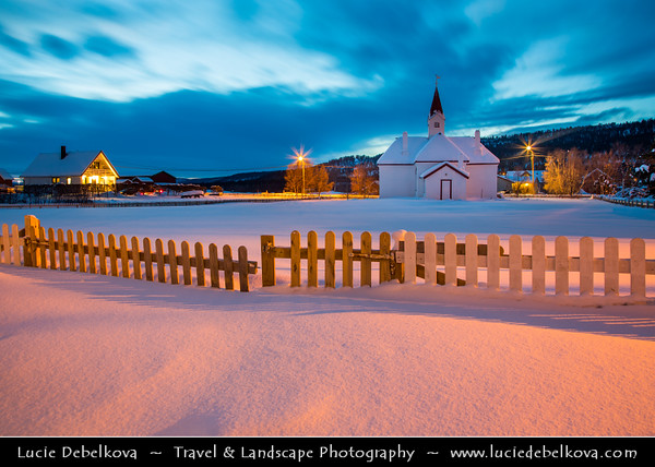 Europe - Scandinavia - Norway - Finnmark - Extreme Northeast of Norway - North of the Arctic Circle - Karasjok - Kárášjohka - Karasjok Church - Karasjok kirke under snow cover during winter at Twilight - Blue Hour - Night - Dusk
