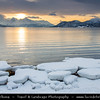 Europe - Scandinavia - Norway - North of the Arctic Circle - Troms county - Fjords around the city under heavy snow cover and very low midday sun light