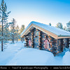 Europe - Scandinavia - Norway - Finnmark - Extreme Northeast of Norway - North of the Arctic Circle - Landscape with traditional wooden houses around Karasjok - Kárášjohka - Under snow cover during winter