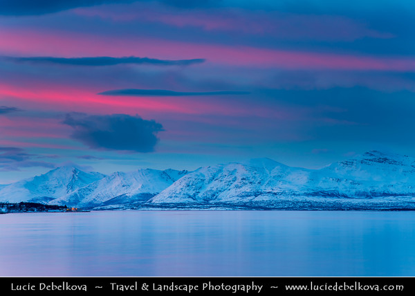 Europe - Scandinavia - Norway - North of the Arctic Circle - Troms county - Tromsø - The capital of the Arctic - Beautiful Nordic city surrounded by mountains, fjords & islands during winter time at Dawn - Twilight - Blue Hour - Night