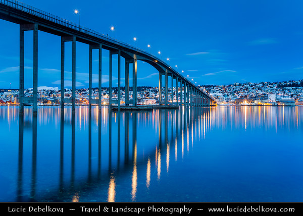 Europe - Scandinavia - Norway - North of the Arctic Circle - Troms county - Tromsø - The capital of the Arctic - Beautiful Nordic city surrounded by mountains, fjords & islands during winter time - City center captured at Dawn - Twilight - Blue Hour - Night