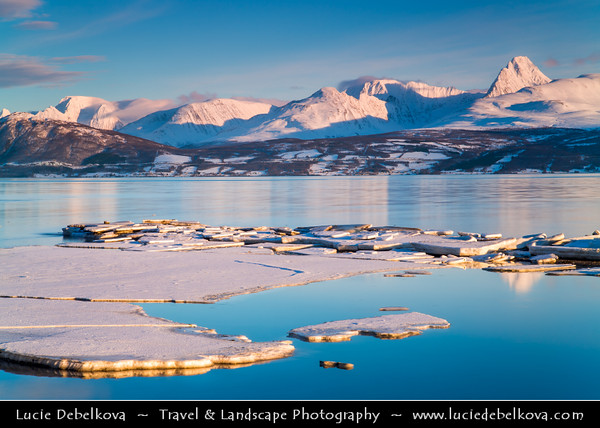 Europe - Scandinavia - Norway - North of the Arctic Circle - Troms county - Tromso Area - Arctic Norway Fjords with surrounding mountains under fresh snow during winter time