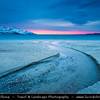 Europe - Scandinavia - Norway - North of the Arctic Circle - Troms county - Arctic Norway Fjords - Tromso & Kvaloya Area - Grotfjord with surrounding mountains under fresh snow during winter time at Sunset - Dusk - Twilight - Blue Hour - Night