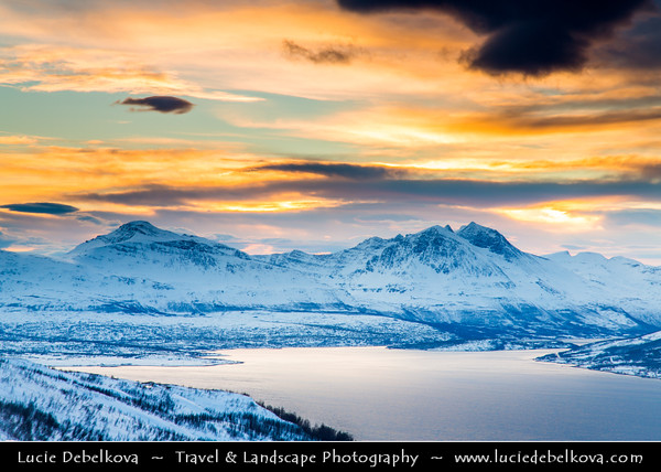 Europe - Scandinavia - Norway - North of the Arctic Circle - Troms county - Tromsø - The capital of the Arctic - Beautiful Nordic city surrounded by mountains, fjords & islands - Fantastic view of Tromsø under snow from Mount Storsteinen (421m/1382ft) during winter time at Sunset - Dusk - Twilight - Blue Hour - Night