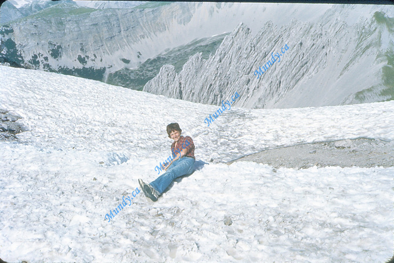 Me relaxing in the snow.  This is snow at the top of a mountain we climbed in Austria.  I was so hot from the climb up that I jumped in the snow and was sliding toward the edge when I heard screams to stop.  I stopped just short of the edge (behind me there) where it goes straight down ...