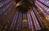 Supported by slender piers, the vaulted ceiling seems to float above magnificent stained-glass windows.