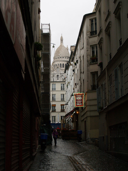 Paris street scene with Sacred Heart Basilica in the distance