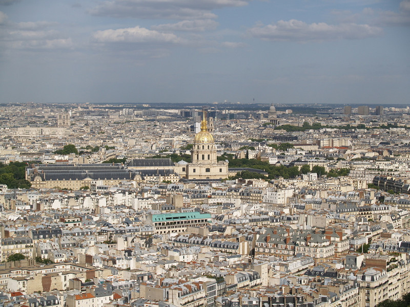 View from Eiffel Tower with gold dome of the Hotel des Invalides (originally built in 17th century as respite for wounded soldiers; now home to the Army Museum).