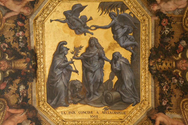 Close up of a piece of art work decorating the ceilings - Chateau de Versailles