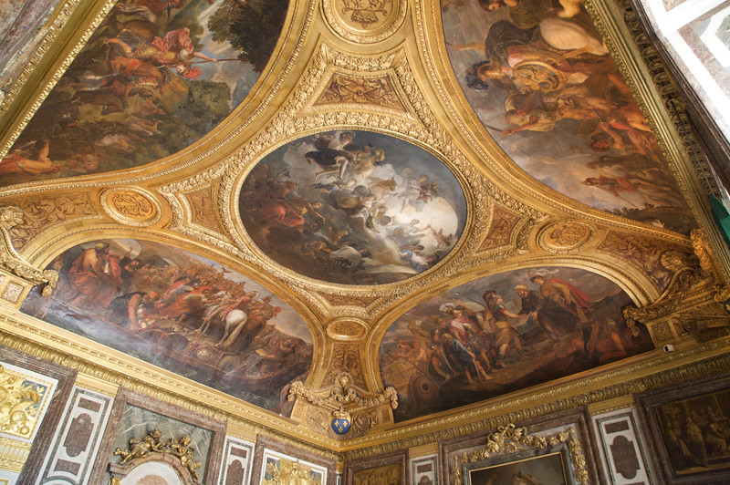 Decorated ceiling of one of the many rooms in Chateau de Versailles