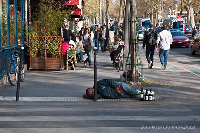 A drunk man sleeping in the street