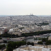 View from the Eiffel Tower, with Sacre Coeur basilica atop the hill at Montmartre, in the distance.