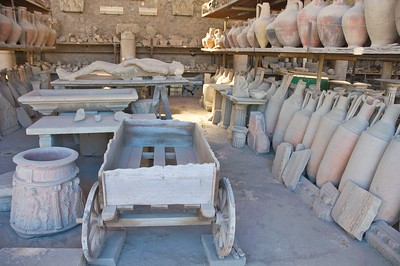 A warehouse full of relics from Pompei. Note the cast of one of the bodies found buried from the volcanic ash.