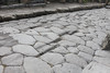 The ruts in the cobblestone are from wagon/chart/chariot wheels dating back before 79 A.D., when Mt Vesuvius covered Pompeii.