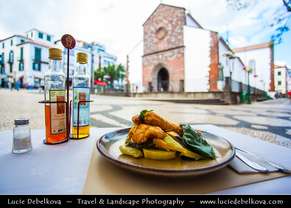 Europe - Portugal - Portuguese archipelago - Madeira Island - South Coast - Funchal - Peixe Espada com banana - Traditional Espada fish of Madeira with Banana in front of Cathedral of Our Lady of the Assumption