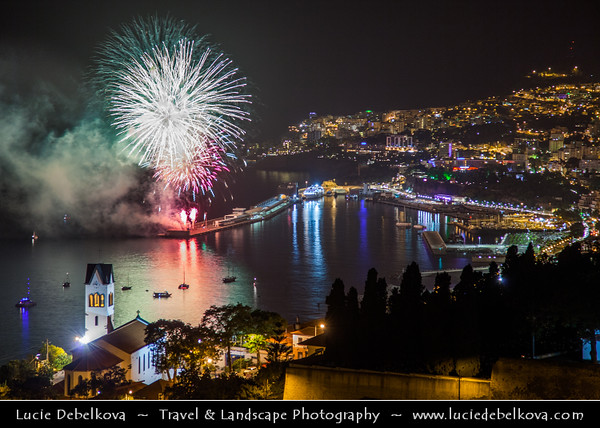Europe - Portugal - Portuguese archipelago - Madeira Island - South Coast - Funchal - Coastal town on shores of Atlantic Ocean - Panoramic view of Funchal Bay & Madeira's Capital - Fireworks over town marina