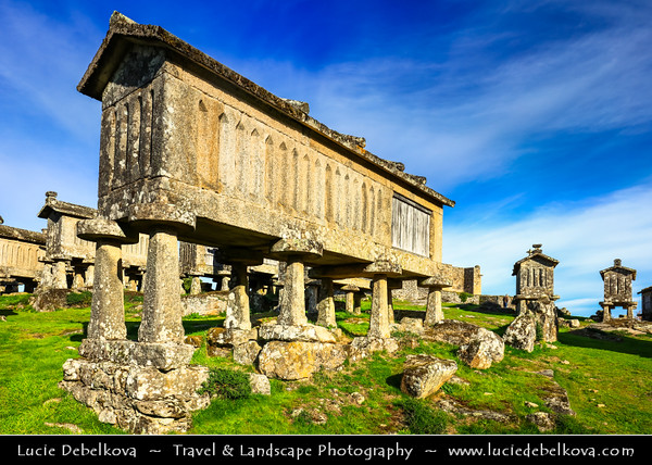 Europe - Portugal - Região Norte - North Region - Lindoso - Espigueiros - Tomb-like granaries, traditional stone corn driers and storage stand near Lindoso castle