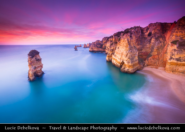 Europe - Portugal - Algarve Region - Lagos Area - Praia Dona Ana - Dona Ana Beach - Atlantic south coast small beach surrounded by steep colourful strata cliffs, golden sands with crystal clear waters