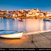 Europe - Portugal - Algarve Region - Ferragudo - Pittoresque historical fishing village with traditional white houses across the river estuary of Rio Arade with Fishing Boats near Portimac