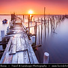 Europe - Portugal - Alcácer do sal - Palafito Pier of Carrasqueira - Masterpiece of folk architecture - Palafito pier spanning hundreds of meters by muddy creeks of the River Sado - Sunset